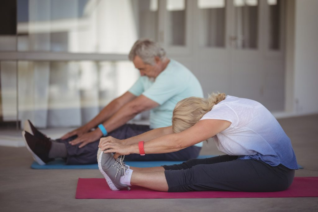 Simply Gym- Older couple working out in living room