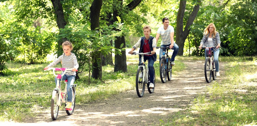 family on bike ride in park - easy ways to exercise - Simply Gym