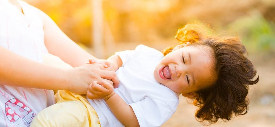 Family Friendly Festivals - Child Smiling with Mother